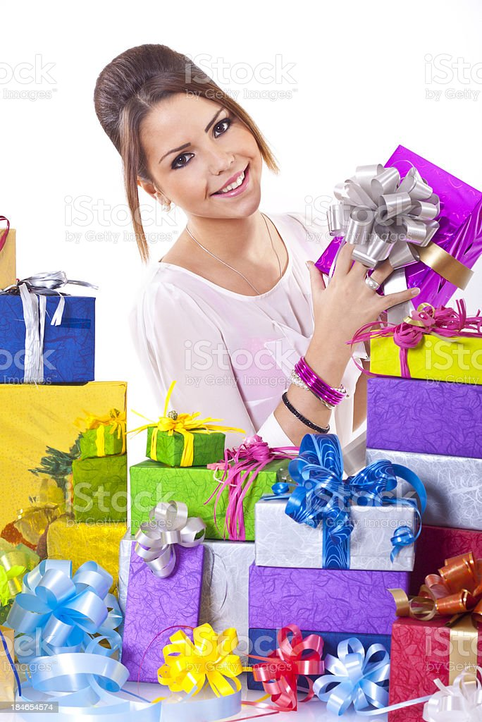 Lot of gifts, girl showing one. royalty-free stock photo