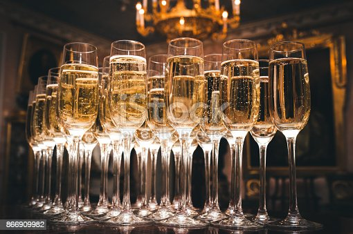istock A lot of glasses of champagne in a luxurious atmosphere. Stylish, toned photo. Secular reception, new year, wedding 866909982