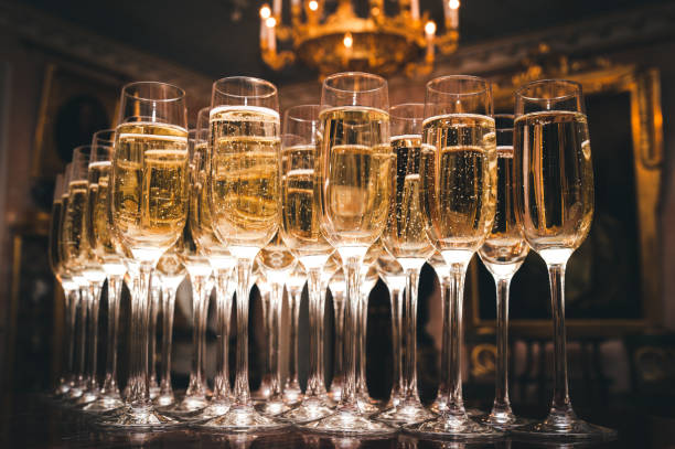 a lot of glasses of champagne in a luxurious atmosphere. stylish, toned photo. secular reception, new year, wedding - champagne stock pictures, royalty-free photos & images