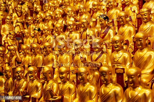 Shanghai, China - May, 2019: Gold statues of the Lohans in Longhua buddhist temple, Shanghai, China