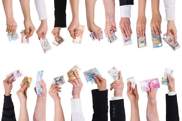 lot of hands with important currencies stock photo