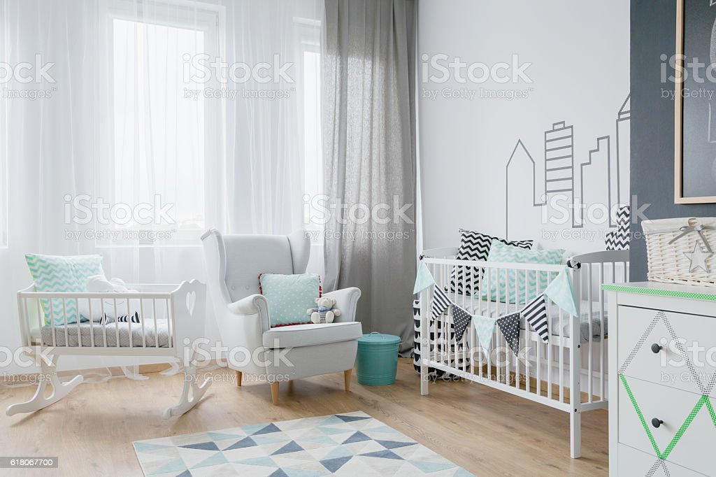 Lot of light in a baby's room stock photo