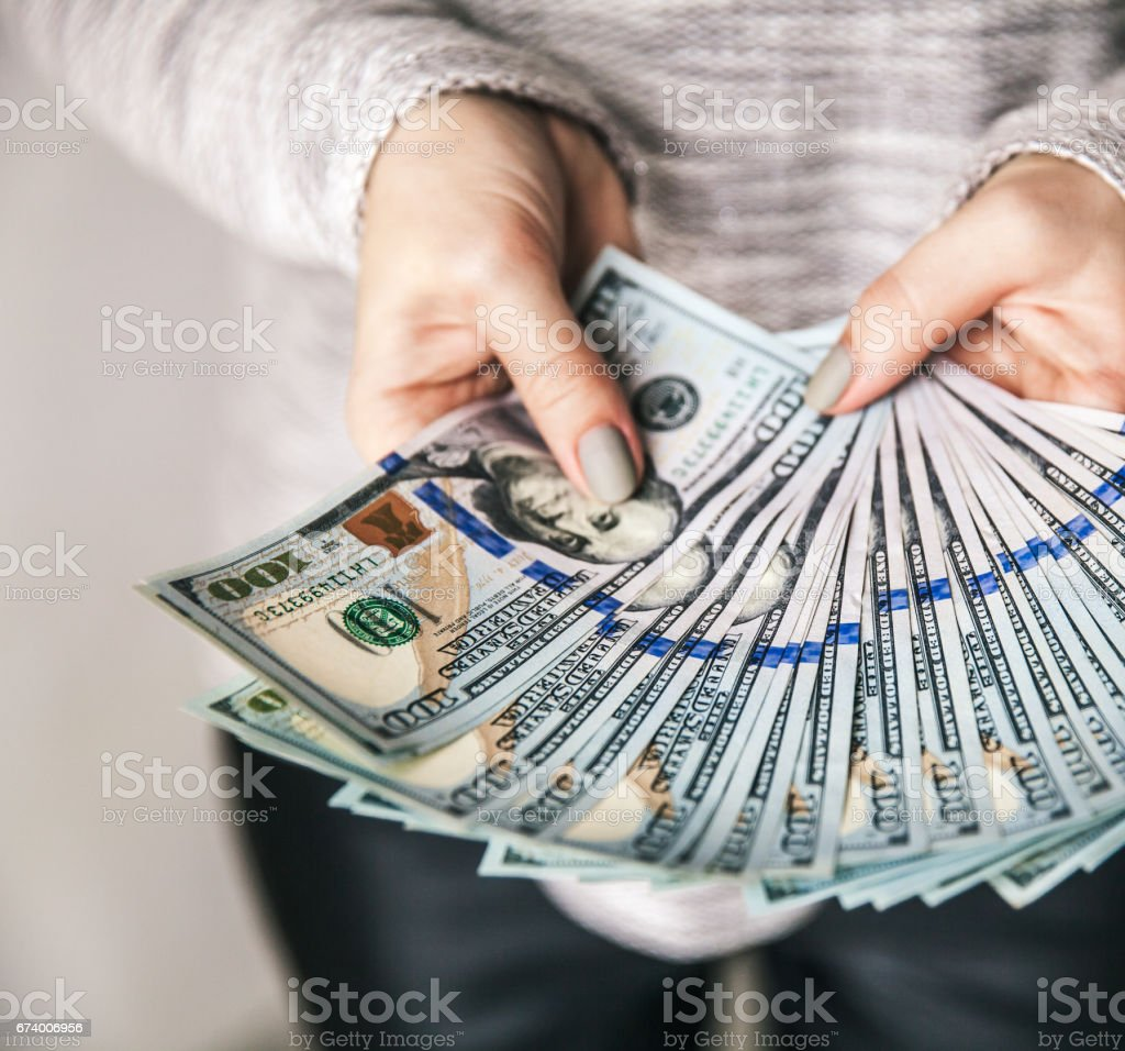 lot of money in female hands. Business. Dollars and prosperity. royalty-free stock photo