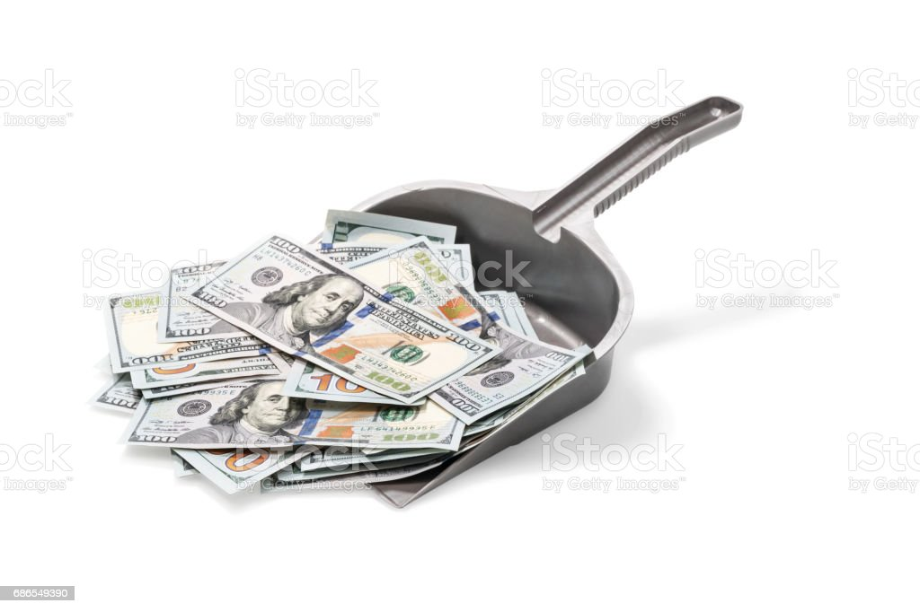 Lot of money on garbage scoop foto stock royalty-free