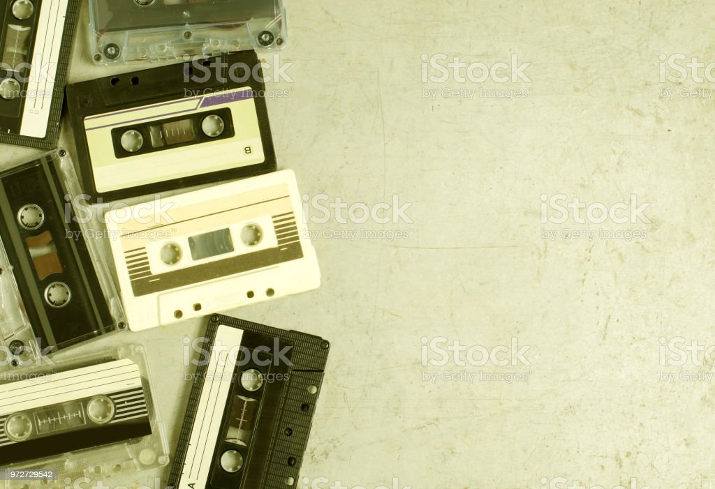 A lot of old audio cassettes. Gray old background. Vintage toned and...