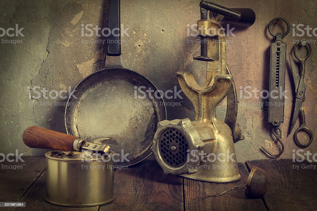 Lot of old kitchen tools - toned photo stock photo
