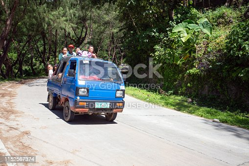 A lot of people driving on a truck from the mountain villages to Dalaguete City. Dalaguete is a municipality in the province of Cebu, Philippines.