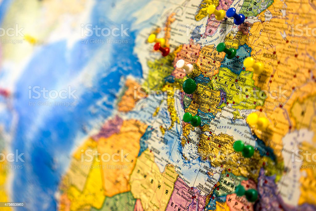 Lot of push pins pointing at European countries, Russian map. stock photo