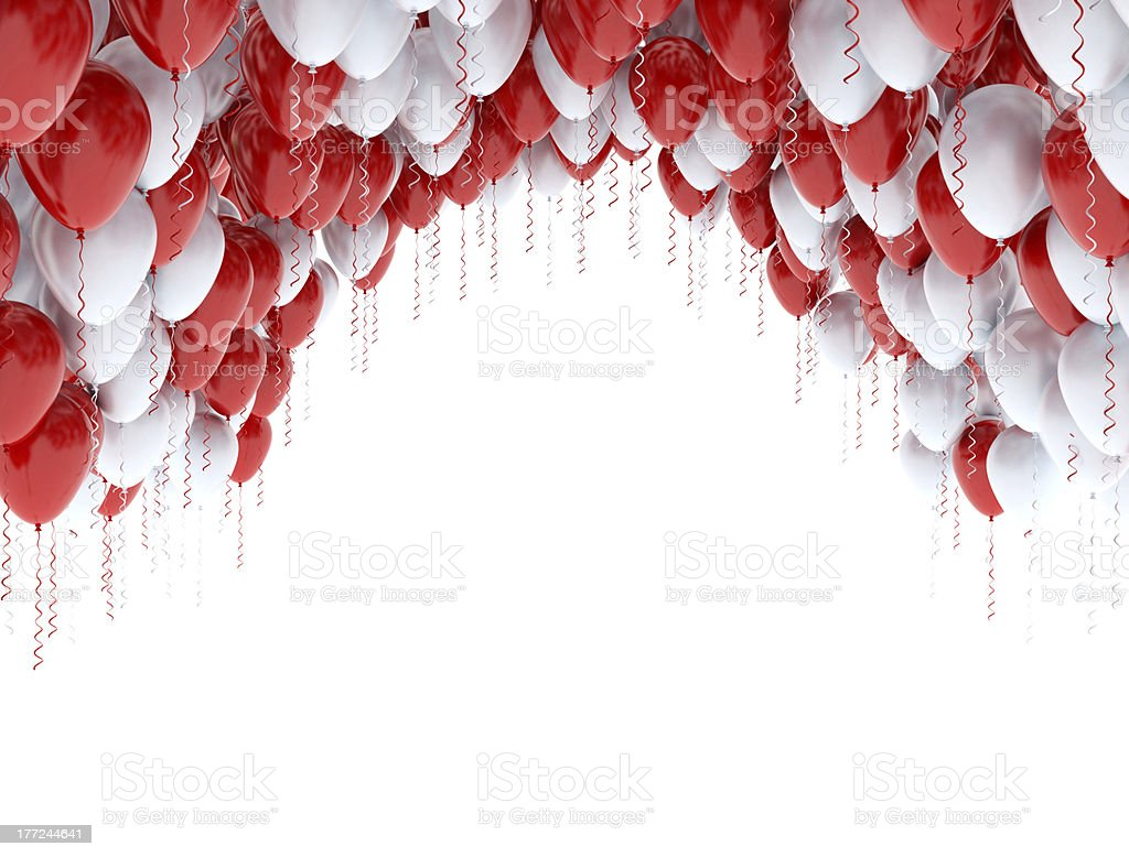 A lot of red and white balloons in a white room stock photo