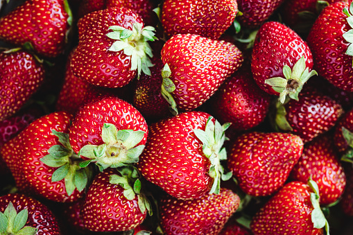 Full frame of fresh and juicy strawberries. Freshly harvest collection of strawberries.