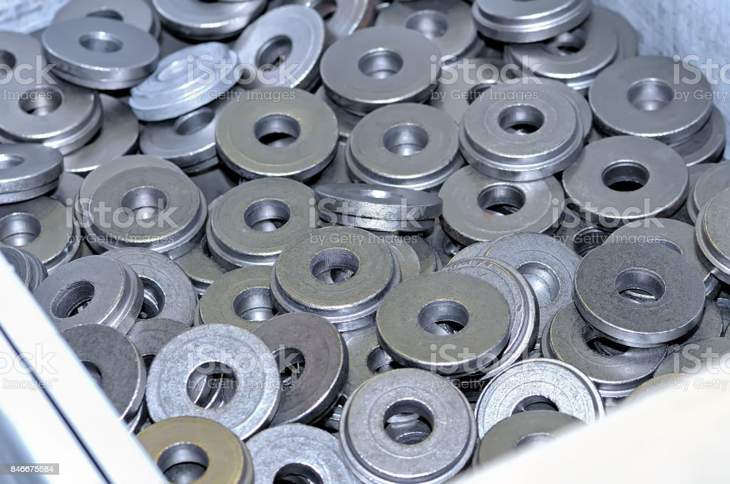 Lot of round metal magnets in bulk stock photo