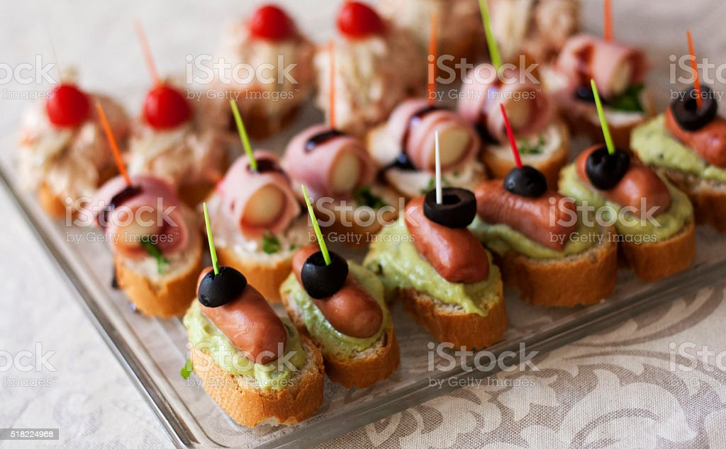lot of sandwiches with sausage and olives. stock photo