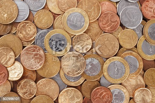 istock Lot of scattered brazilian real coins 502996101