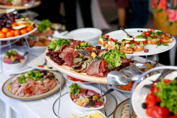 a lot of snacks on event catering - pranzo di natale foto e immagini stock