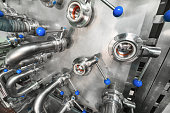 istock A lot of steel ball valves with blue handles mounted on a metal wall 905481026