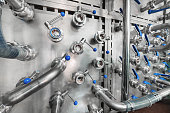 istock A lot of steel ball valves with blue handles mounted on a metal wall 938404984