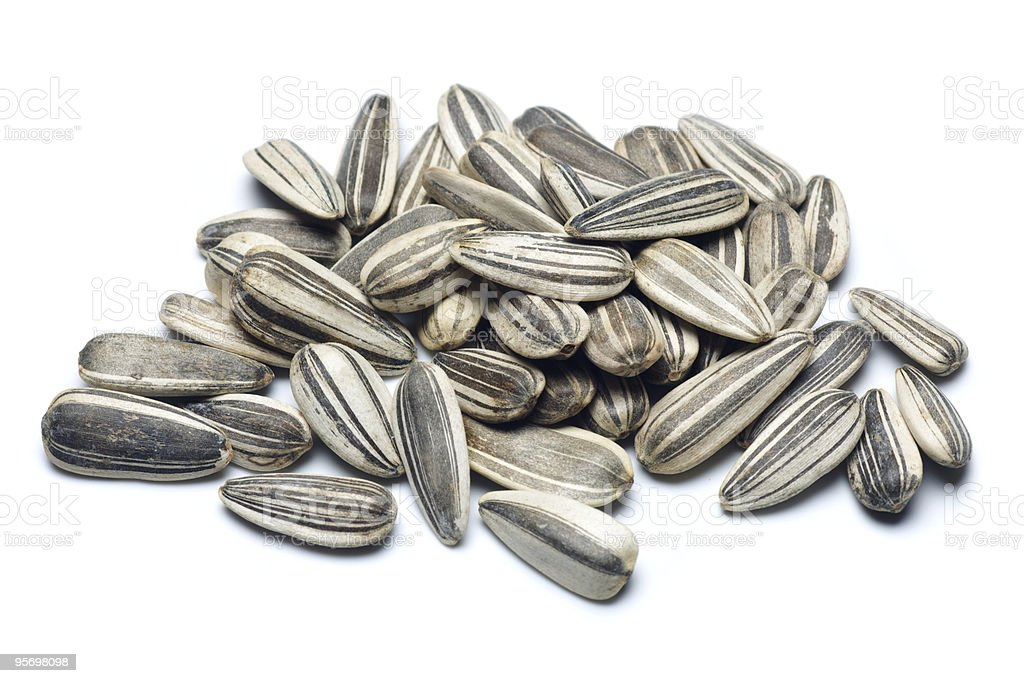 A lot of sunflower seeds on white background stock photo