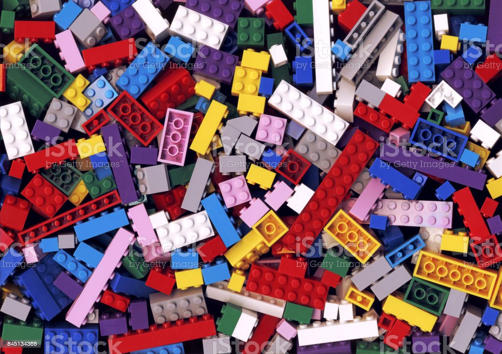 Lot of various colorful Lego blocks background stock photo