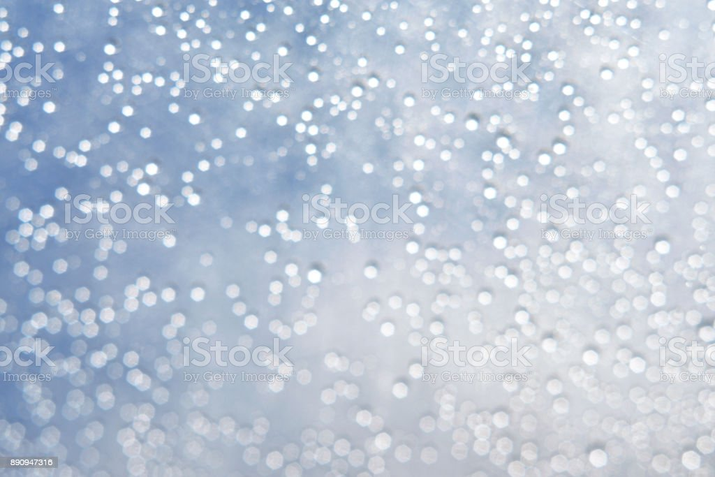A lot of water droplets defocus bokeh abstract light background. stock photo