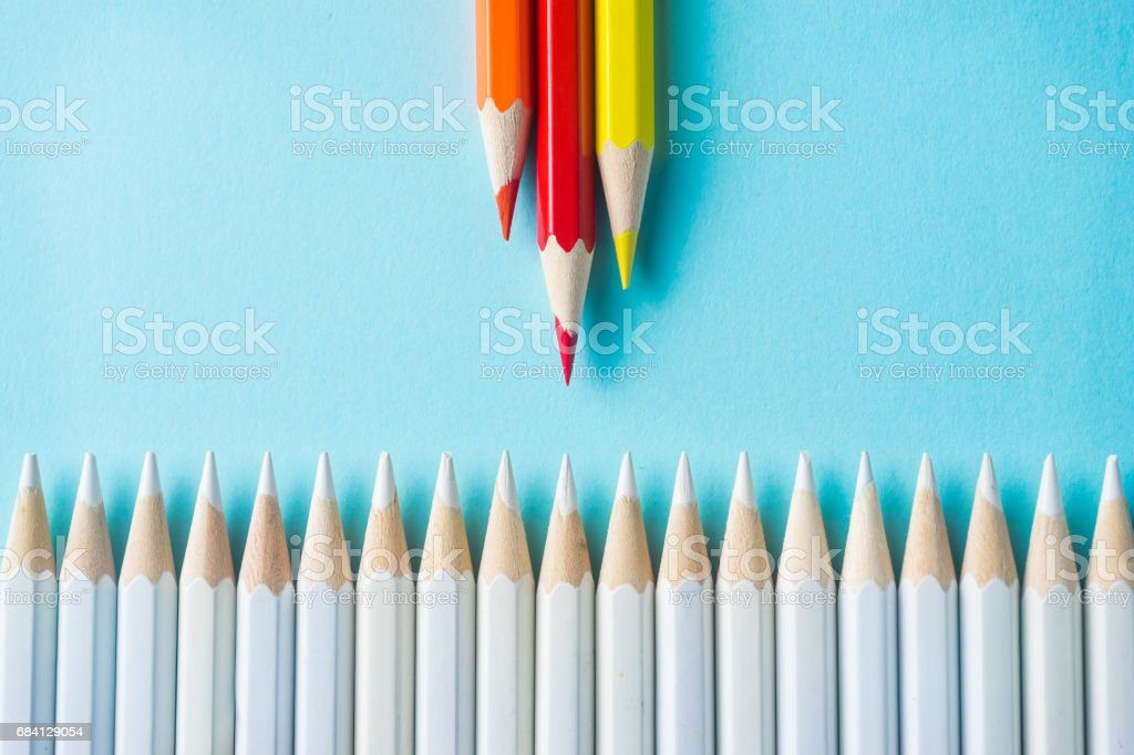 lot of white pencils and color pencil on blue paper background. foto stock royalty-free