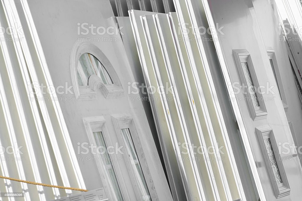 Lot of white plastic door stock photo