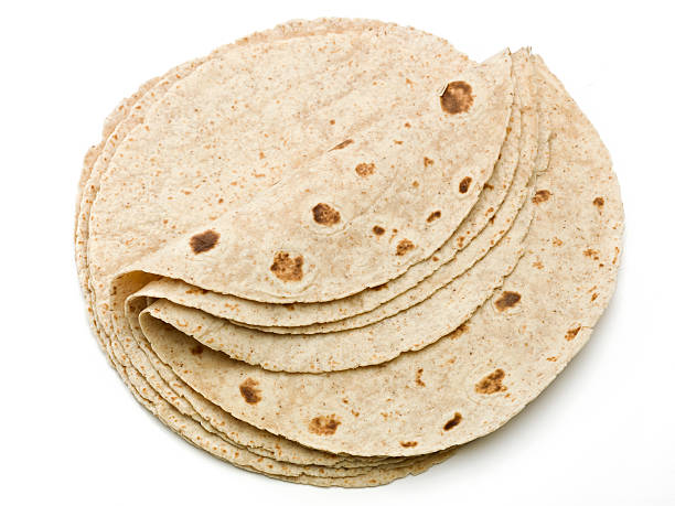 lot of whole wheat flour mexican tortillas - tortilla stock photos and pictures