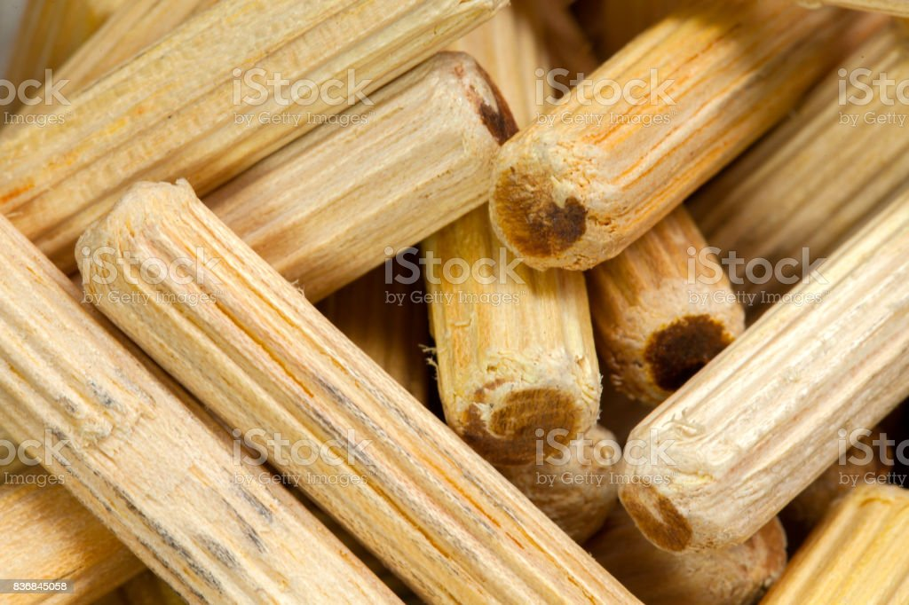 A lot of wooden pegs stock photo