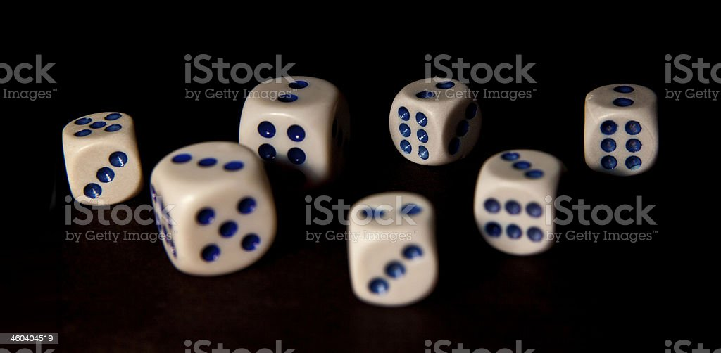 lot white dice are on a solid black background royalty-free stock photo