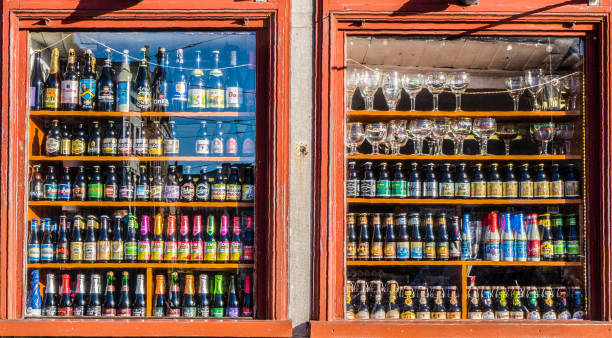 Lots of alcoholic drinks in shelfs of a pub stock photo