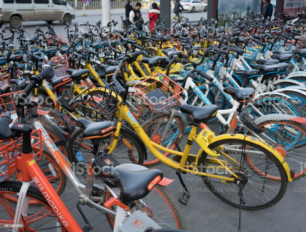 Lots of bike sharing of several brands closeup with company logo of Mobike Hellobike and Ofo stock photo