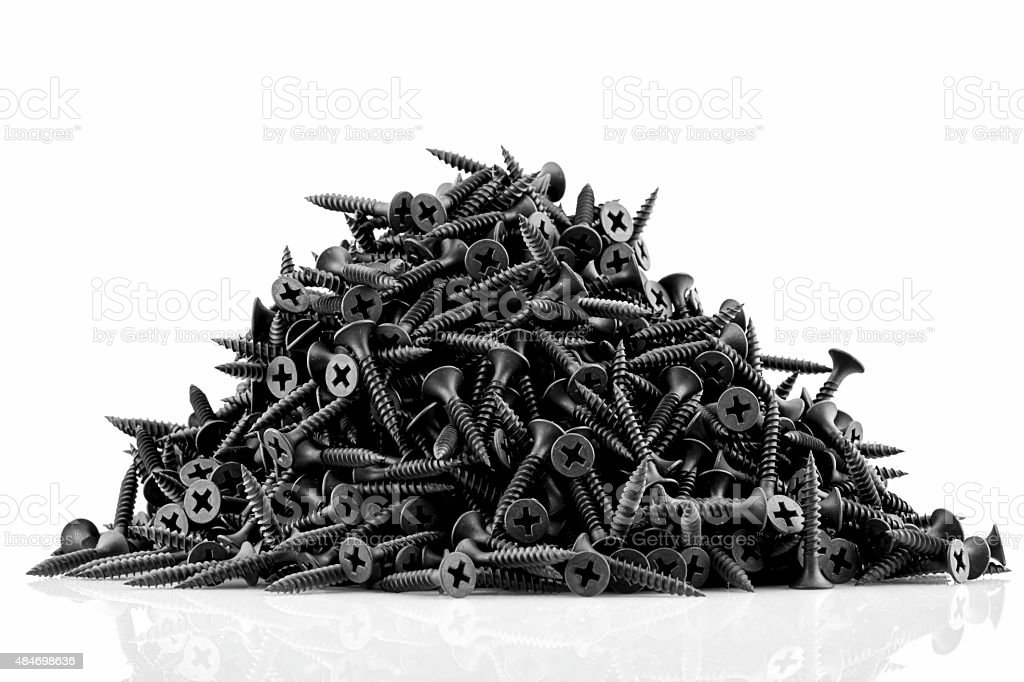 Lots of black screws isolated on white background stock photo