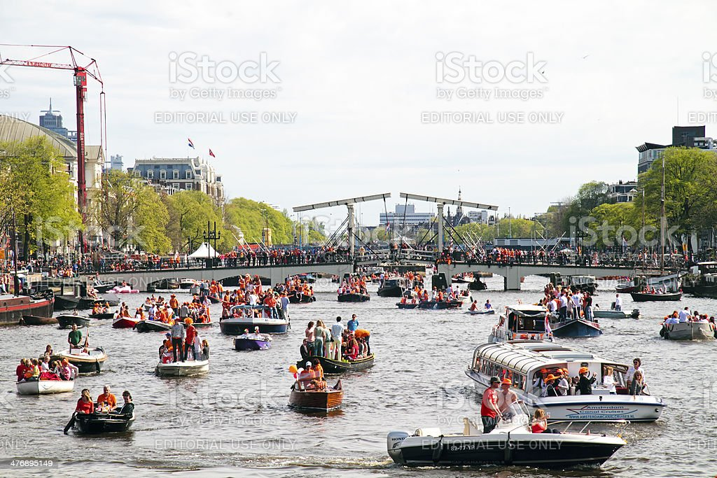 Lots of boats partying on the river Amstel Amsterdam Netherlands stock photo