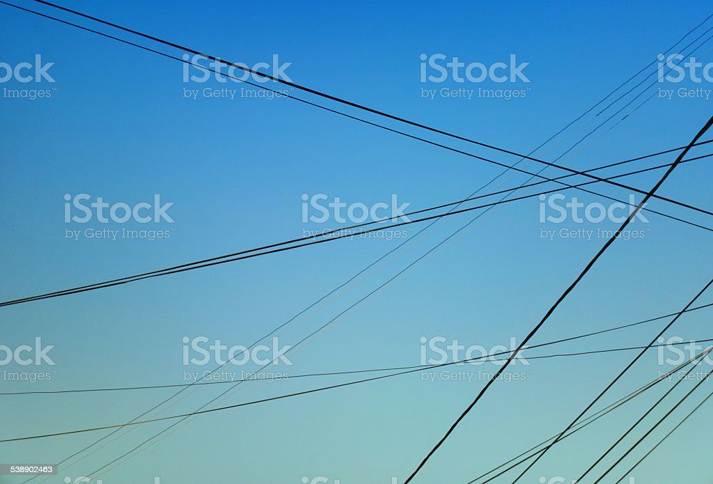 Lots of cables in the sky stock photo