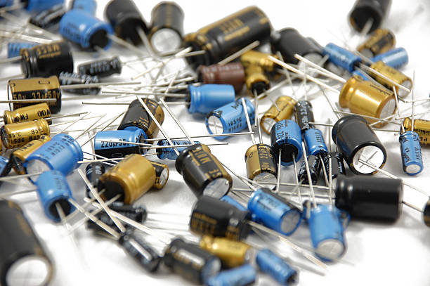 lots of capacitors on white background wallpaper - capacitor stock photos and pictures