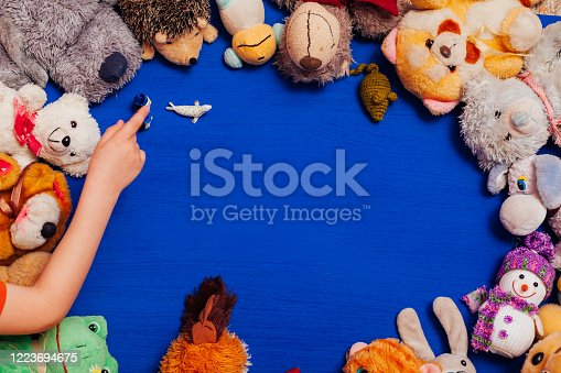 544818734 istock photo Lots of children's toys for child development games on a blue background 1223694675
