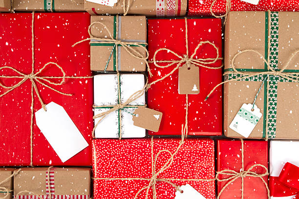 Lots of Christmas Gifts Boxes with Tags - foto stock