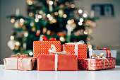 istock Lots of christmas presents on a table 518912429