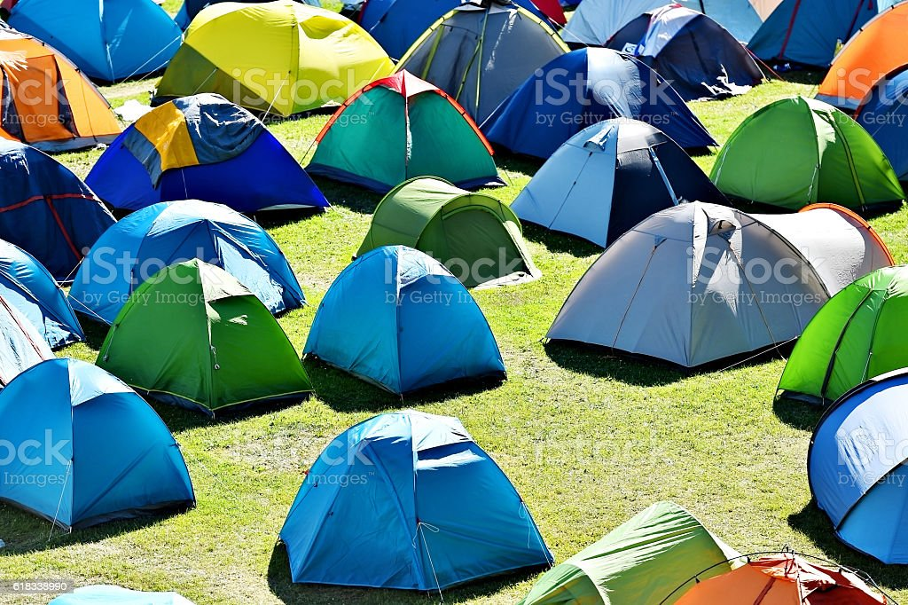 Lots of colorful tents on a meadow stock photo