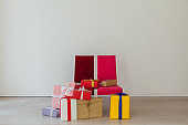 istock Lots of festive Christmas gifts new year birthday 1219515849