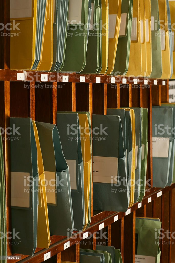 lots of folders containing documents in pigeon holes stock photo