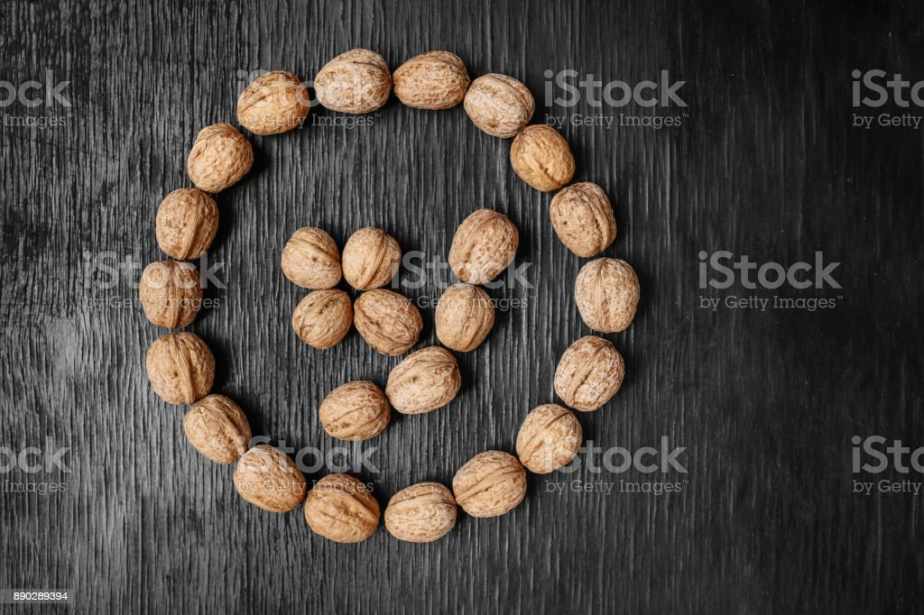 Lots of fresh nuts on a black wooden background. Best practices for designer. A beautiful design from the nuts stock photo