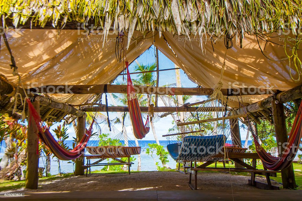 Lots of hammocks under the roof stock photo