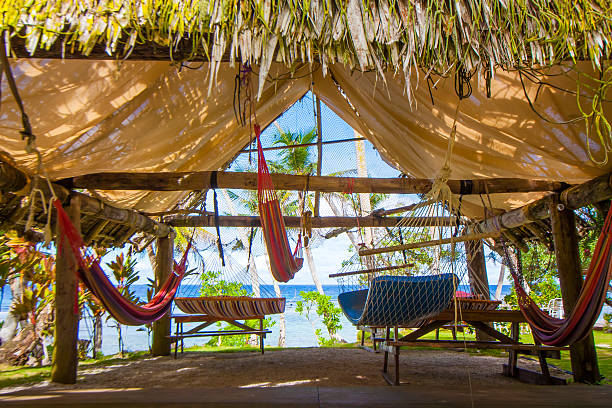 lots of hammocks under the roof - guam foto e immagini stock
