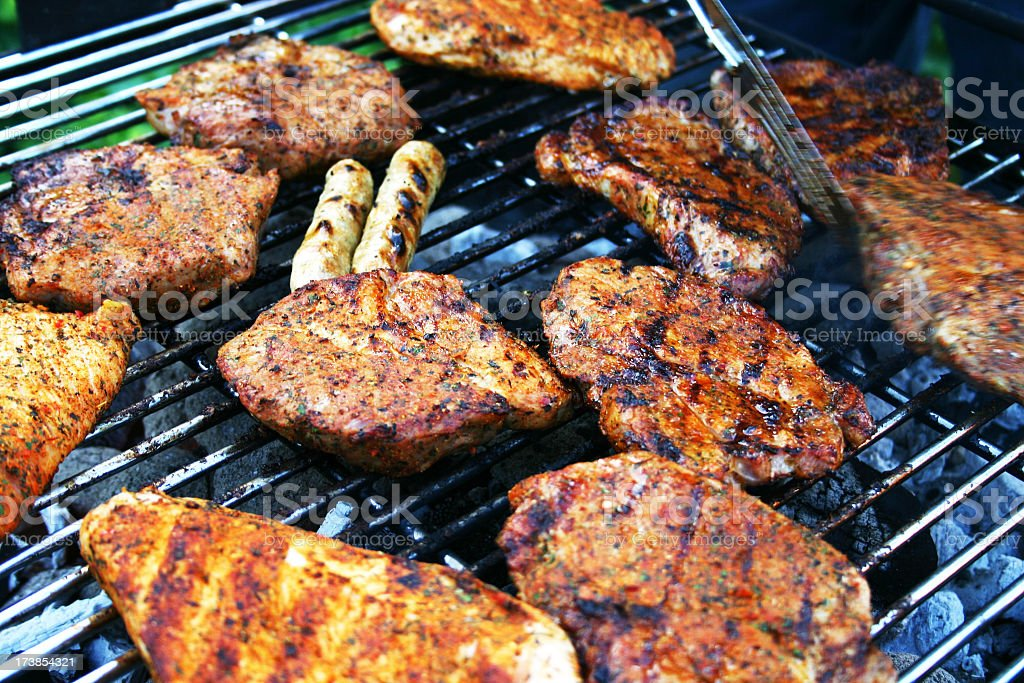 Lots of meat on a bbq grill royalty-free stock photo