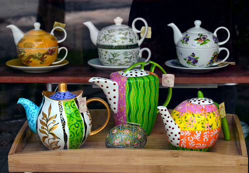 Lots of multicolored ceramic teapots.