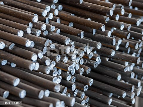 687475318 istock photo Lots of old metal bars stacked on top of each other 1194114167