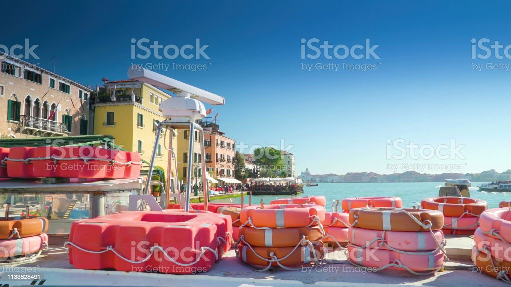Lots of orange bouys on the port in Zattere stock photo