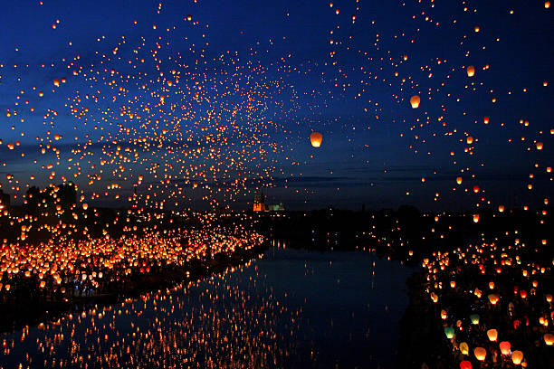 Lots of Paper Fly Lanterns next to the River A large collection of flying chinese lanterns next to the River lantern stock pictures, royalty-free photos & images