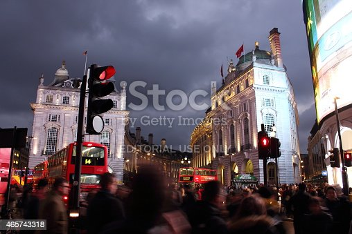 istock Lots of people, cars and red buses in Piccadilly Circus 465743318