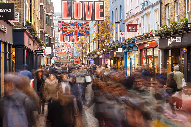 Lots of people Christmas shopping on Carnaby Street, London. London, England - December 17, 2016: Lots of people Christmas shopping on Carnaby Street, London. In London, England. On 17th December 2016. carnaby street stock pictures, royalty-free photos & images